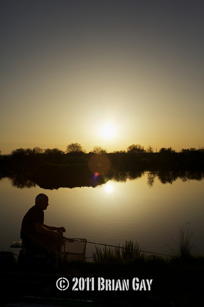 As the sun goes down Jamie Cook in silhouette during the top kit challenge at the Sedges, Bridgwater, Somerset. © 2011 Brian Gay