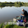 Jamie Cook, baits up during the top kit challenge at the Sedges, Bridgwater, Somerset. © 2011 Brian Gay