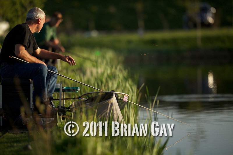 Jamie Cook throws some bait into the margin of his swim during the top kit challenge at the Sedges, Bridgwater, Somerset. © 2011 Brian Gay