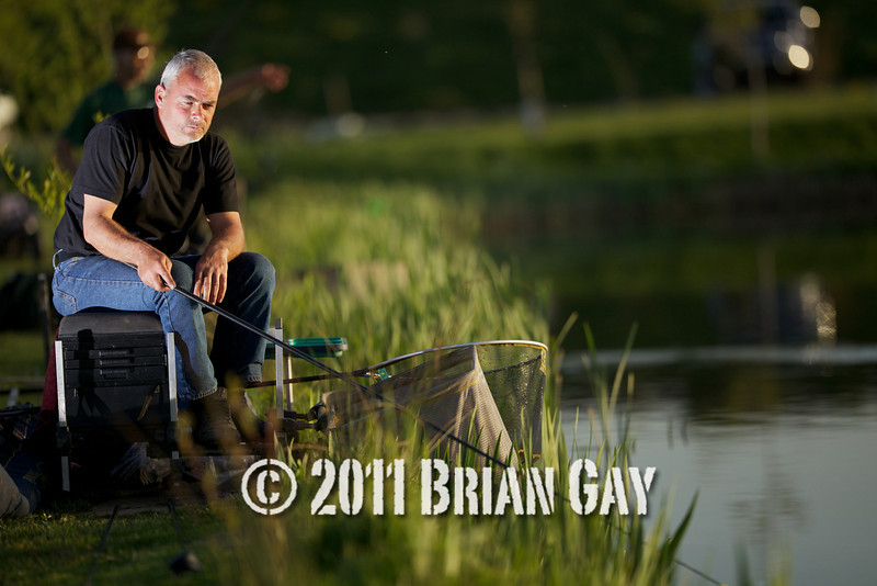 Jamie Cook, fishing the margins during the top kit challenge at the Sedges, Bridgwater, Somerset. © 2011 Brian Gay