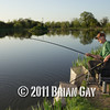 Jamie Smith looks on as Brian Gatiss plays a carp during the top kit challenge at the Sedges, Bridgwater, Somerset. © 2011 Brian Gay