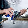Brian Gay sprays line floatant onto the line loaded onto a Drennan FD 3000 reel.
