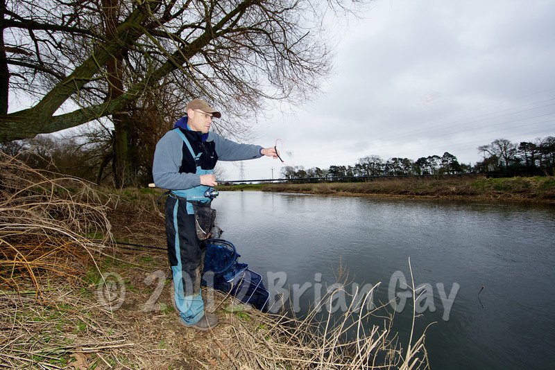 Brian Gay fires a pouch of maggots upstream as he fishes Beat 2 on the Dorset Stour Throop Fishery.
