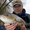 Brian Gay holds a 4 lb Dorset Stour chub caught from the Throop Fishery.