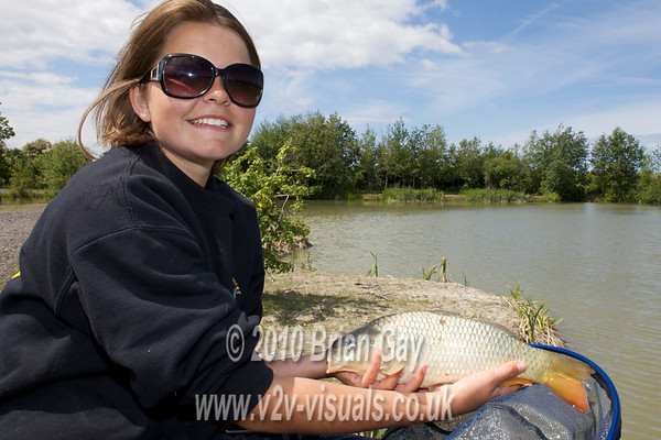Misha Herring with a small common carp at Trinity Waters, Woodland Lake, 280510. © 2010 Brian Gay