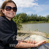 Misha Herring with a small common carp at Trinity Waters, Woodland Lake, 280510. © 2010 Brian Gay