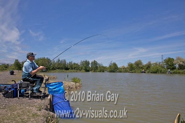 First carp is hooked. Brian Gay fishing the Pellet Waggler at Trinity Waters, Woodland Lake, 280510. © 2010 Brian Gay