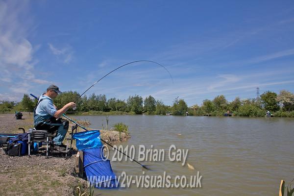 Preparing to net a carp. Brian Gay fishing the Pellet Waggler at Trinity Waters, Woodland Lake, 280510. © 2010 Brian Gay