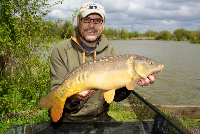 First fish of the day 9 lb mirror on a cell / rig foam combo in the left hand margin