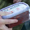 Preparing the Advantage Baits Krill Pellet Method Box, shaking the liquid through the pellets,