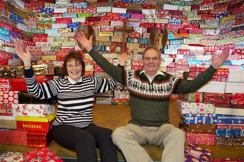 Jean and Mike Pennington-Ridge at the Bicknoller Church with the 2012 Operation Christmas Child shoe box collection.