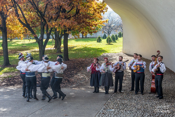 Men Dancing with Band