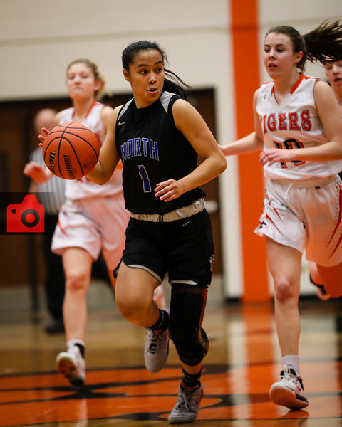 Leilauni Chanthaboury looks behind as she races towards an uncontested layup