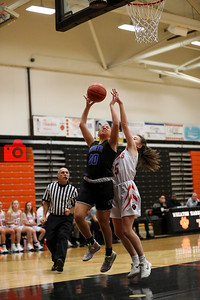 Talia Pellegrini is fouled attempting a layoup.