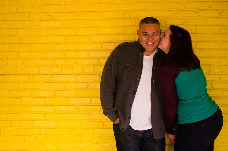 Couple inside the Prairie St. Brewhouse, in Rockford, Il during an engagement portrait photo session.