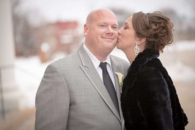 Bride and groom after their wedding ceremony in downtown Rockford, Illinois at Trinity Lutheran Church. Wedding Photographer - Ryan Davis Photography
