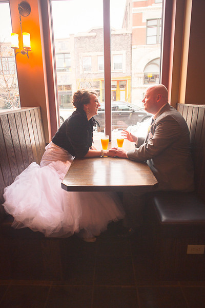 Bride and groom and bridal party at Carlyle Brewing Co. in downtown Rockford, Illinois after their wedding ceremony  at Trinity Lutheran Church. Wedding Photographer - Ryan Davis Photography