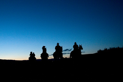 Silhouette: Riders at Dawn