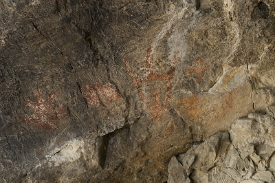 Paintings from left to right depict a human hand, a rectangular box, a possible anthromorph, a bear and a cross. all show signs of traditional scratching.  This scratching is a traditional practice of collecting the paint off the cave walls in order to gain power from the original painter.