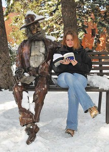 Walt Whitman and a student quietly reading in MSU's Wilson courtyard.