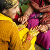 Indian wedding ritual, brides hands are covered with Tumeric