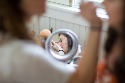 Bride getting makeup