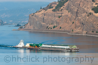 Tidewater tug pushing barge #20 loaded with Rohde & Liesenfeld project on the Columbia River.
