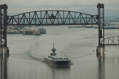 Express Marine Barge EMI 2400 heading downriver on Willamette, departing Portland for the East Coast.