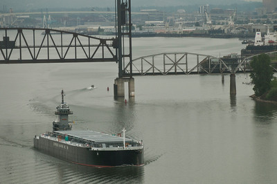 Express Marine Barge EMI 2400 heading downriver on Willamette, departing Portland for the East Coast. Gunderson Marine facility cranes can be seen in the distance.