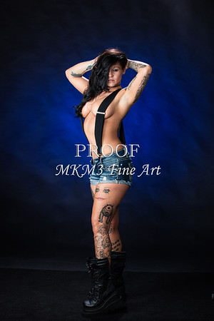 Body art tattoos displayed by Sara.  The photographer is Mac Miller, Tyler, Texas.