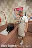 Roxanne & Joe Baylock, Burlingame Mayor Cathy Baylock's dog and husband respectively, test the solar pet wash at Petfood Express's new Burlingame store