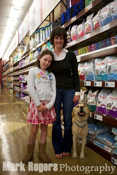 Burlingame City Council member Ann Keighran with her daughter KateRose and dog, Maggie at the Burlingame Pet Food Express grand opening