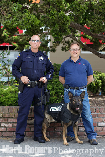 Burlingame Police Officer Roy Bryson and his partner, Ivan, of the Burlingame PD K9 Unit and Michael Levy