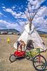 Biker preparing to spend the night in teepee in Cody, Wyoming - 2-Edit - 72 ppi