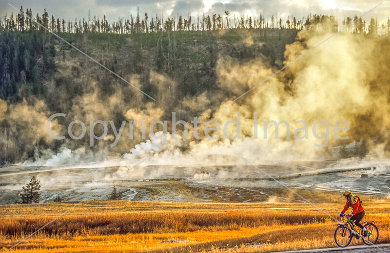 Biker on paved walking-bike path from Old Faithful Geyser to Morning Glory Pool - 7-Edit - 72 ppi