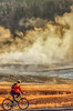 Biker on paved walking-bike path from Old Faithful Geyser to Morning Glory Pool - 9-Edit - 72 ppi-2