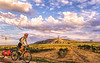 Touring cyclist on Oregon Trail at Chimney Rock National Historic Site in Nebraska - 1 - 72 ppi
