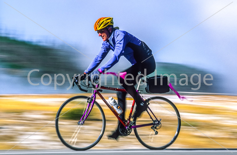 Cyclist(s) at Midway Geyser Basin on West Yellowstone to Old Faithful ride, Yellowstone Nat  Park - 5-Edit - 72 ppi