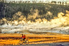 Biker on paved walking-bike path from Old Faithful Geyser to Morning Glory Pool - 2-Edit - 72 ppi
