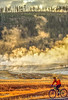 Biker on paved walking-bike path from Old Faithful Geyser to Morning Glory Pool - 5-Edit-Edit - 72 ppi