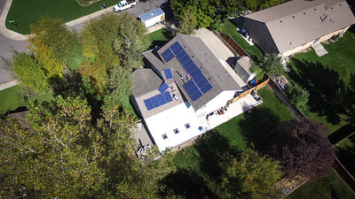2016-10-04 – They installed our solar panels today and near the end of the installation I took my drone up and shot this arial view. We needed 21 panels and they have two left to put in place. This should be enough to cover our power bill for the rest of the years we remain in this home. Less expensive on a monthly average than our power bill and they are paid off in 15 year. They have a 25 year warranty on them so I think we're good.