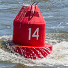 Red buoy floating on water - USA