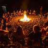 Group of people sitting around camp fire - Mexico
