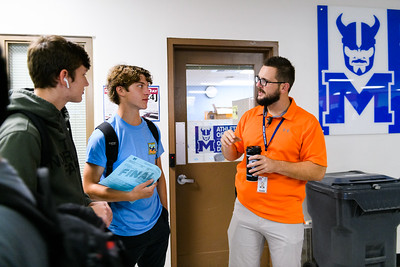 Behavior specialist Sam Wilkerson, right, helps a student find his classes. Back to school day at McNary High School on Wednesday, September 4, 2019 in Keizer, Ore.