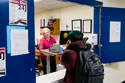 Attendance secretary Kim Ginther chats with a student. Back to school day at McNary High School on Wednesday, September 4, 2019 in Keizer, Ore.