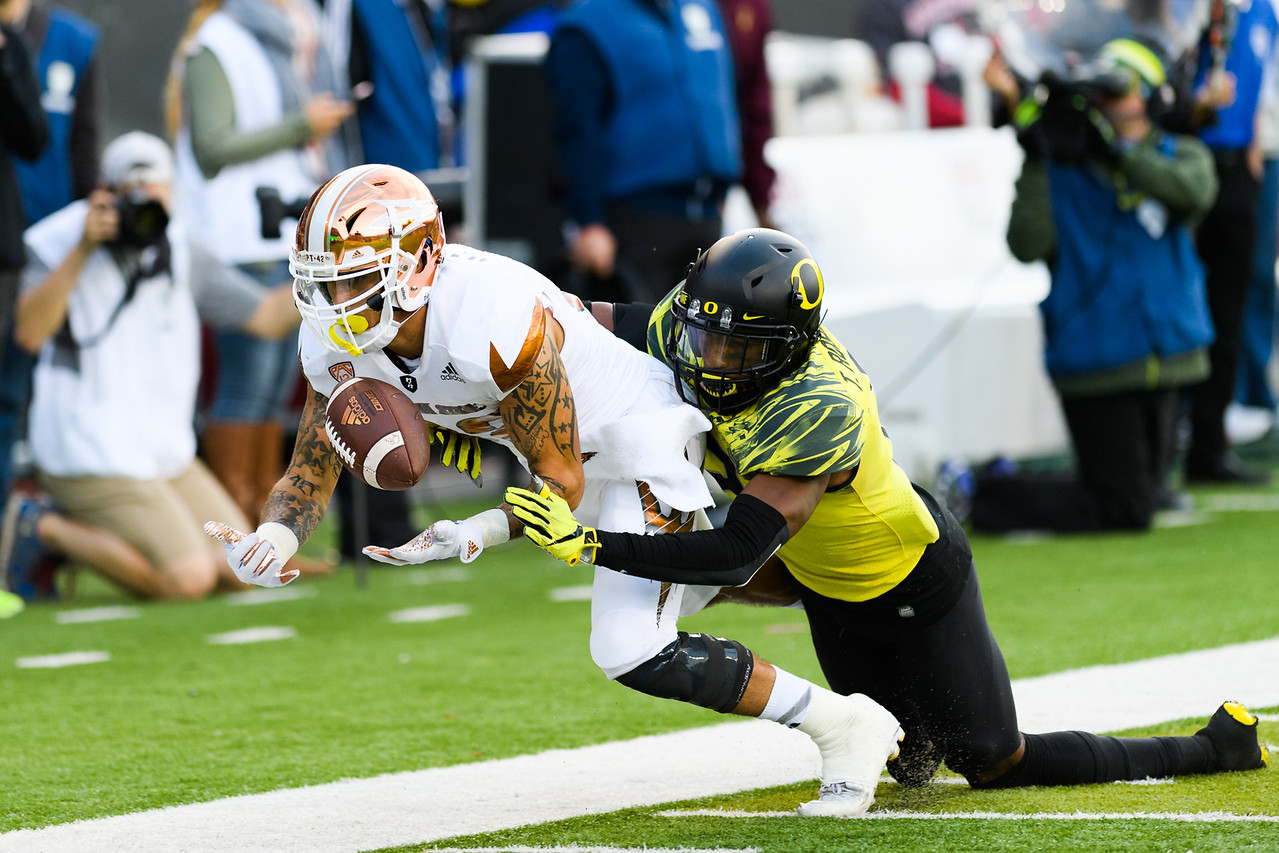 ASU redshirt sophomore wide receiver Jalen Harvey (82) is pressured by Oregon redshirt junior defensive back Tyree Robinson (2) during the fourth quarter. The Arizona State Sun Devils face the Oregon Ducks at Autzen Stadium in Eugene, Oregon on October 29, 2016. (Michael Arellano/DieHard Devil)