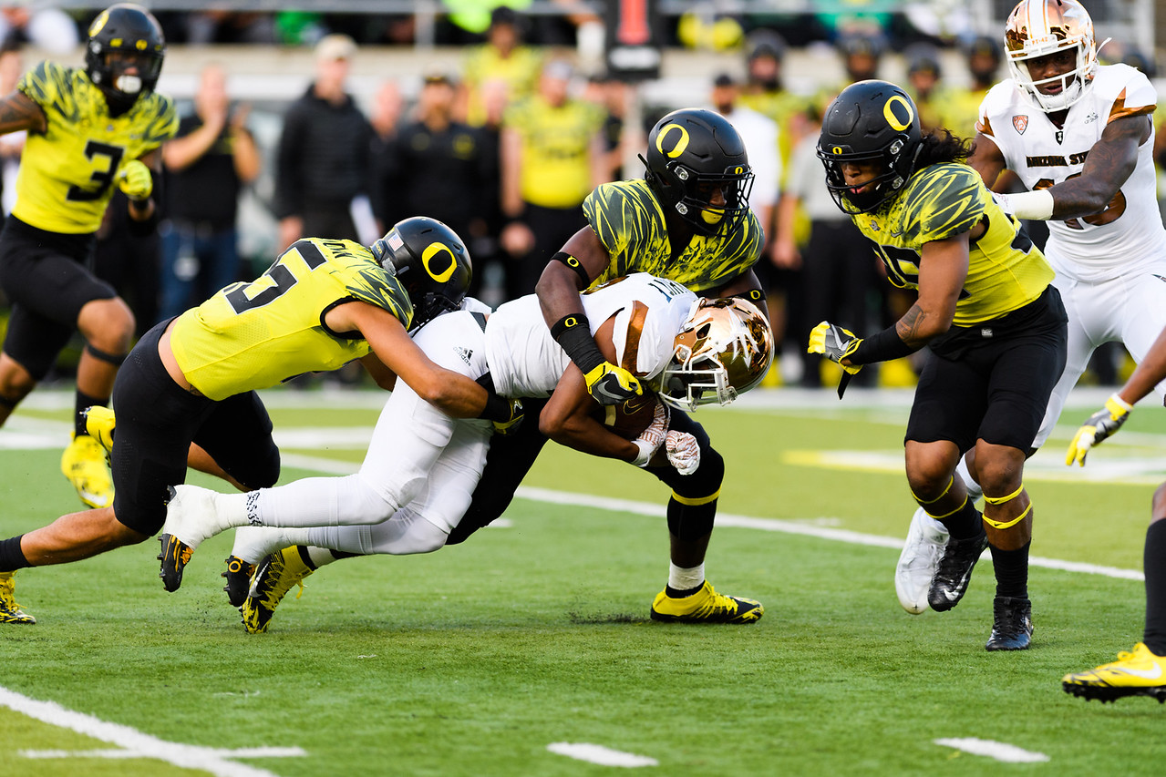 Sun Devil redshirt senior wide receiver Tim White is brought down by a trio of Ducks during a carry in the fourth quarter. The Arizona State Sun Devils face the Oregon Ducks at Autzen Stadium in Eugene, Oregon on October 29, 2016. (Michael Arellano/DieHard Devil)