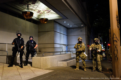 Federal police respond to protestors erecting fencing around the Multnomah County Justice Center. Ongoing protests against police brutality on Friday, July 17, 2020, in Portland, Ore. (Michael Arellano for DailyMail.com)