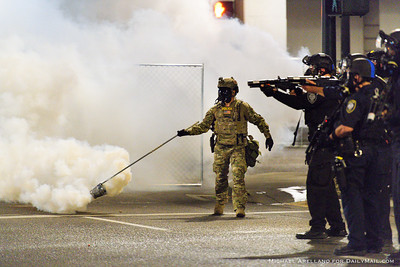 Federal police deploy tear gas against protestors outside the Multnomah County Justice Center. Ongoing protests against police brutality on Friday, July 17, 2020, in Portland, Ore. (Michael Arellano for DailyMail.com)