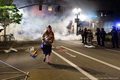 A protestor reacts to tear gas outside the Edith Green-Wendell Wyatt federal building. Ongoing protests against police brutality on Friday, July 17, 2020, in Portland, Ore. (Michael Arellano for DailyMail.com)
